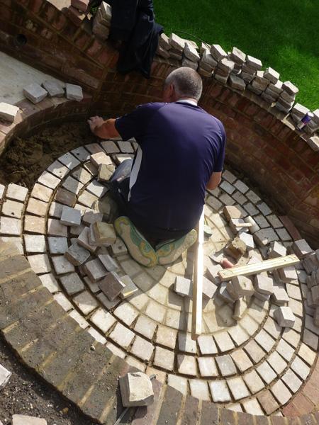 circular paving design for country garden