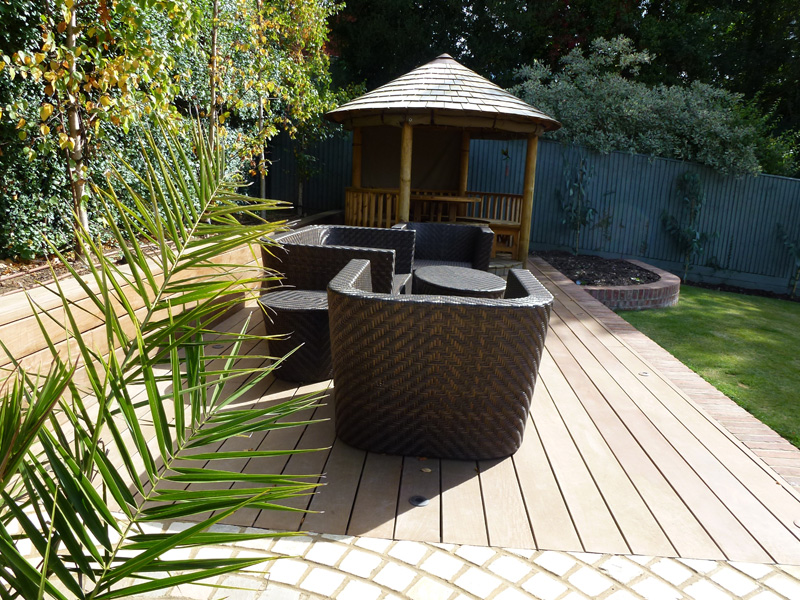 contemporary decking and seating area designed for country garden