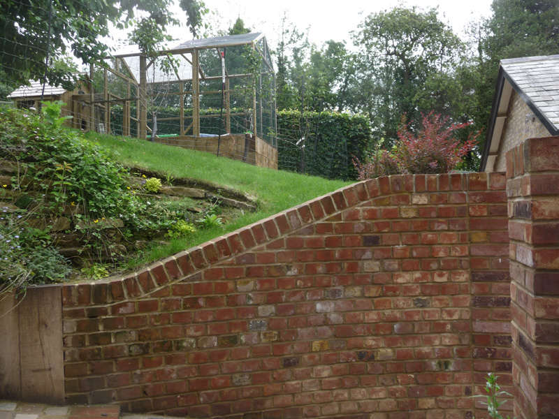 Country garden retaining brick wall