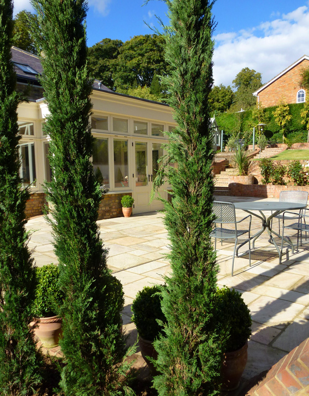 courtyard garden design with seating area in suntrap