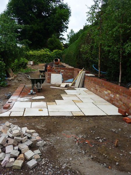 sandstone patio being built in country garden
