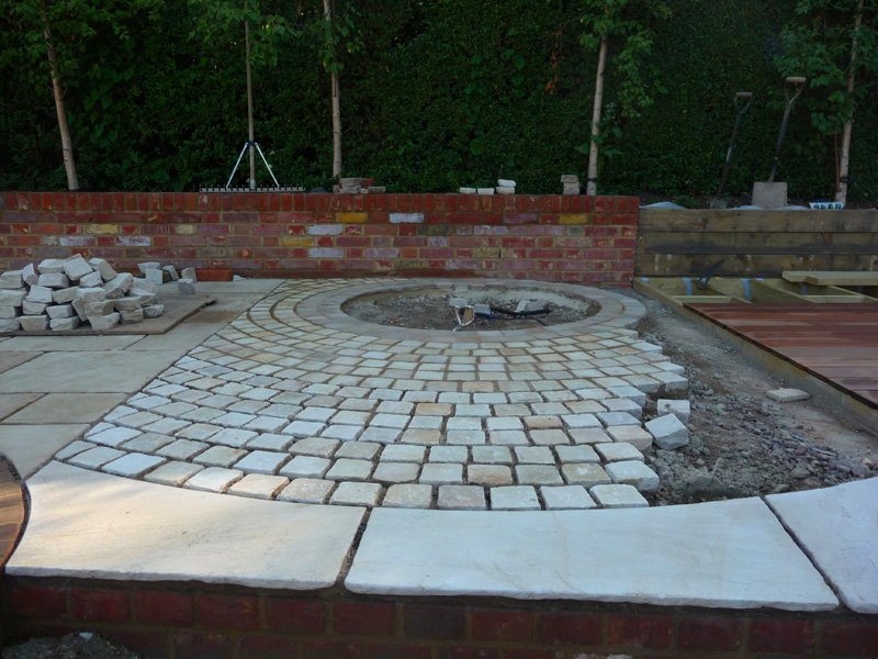 contemporary circular paving design for country garden