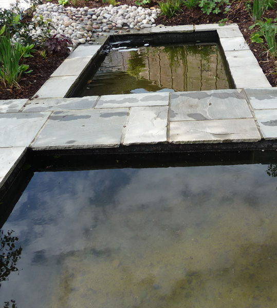 contemporary water feature with two calm pools