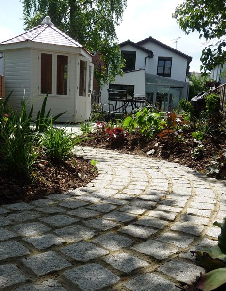 cobbled garden path in contemporary garden