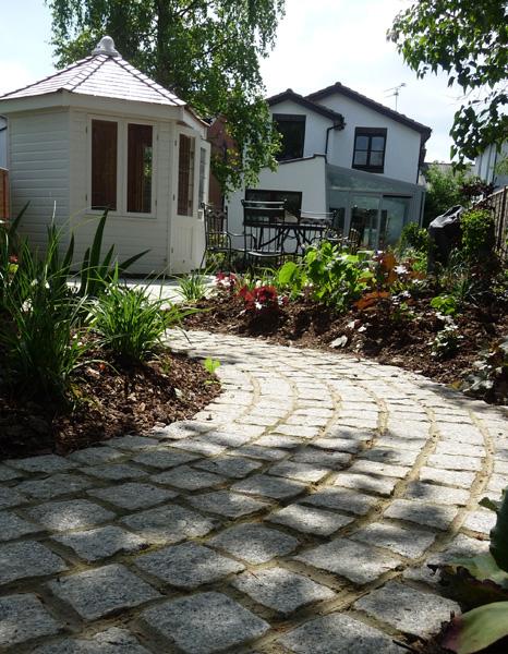 cobbled garden path in contemporary garden