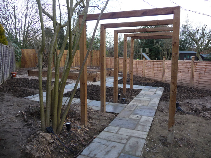 wooden pergola and garden path in contemporary garden's construction phase