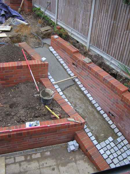 cobbled granite garden path being built in family garden
