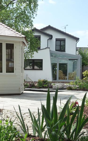 garden design complementing modern house exterior